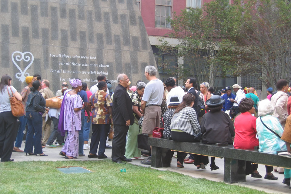 Visitors gather at the African Burial Ground monument